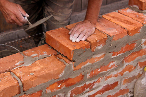 laying bricks photo