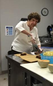 Carolyn Lack cutting brownies