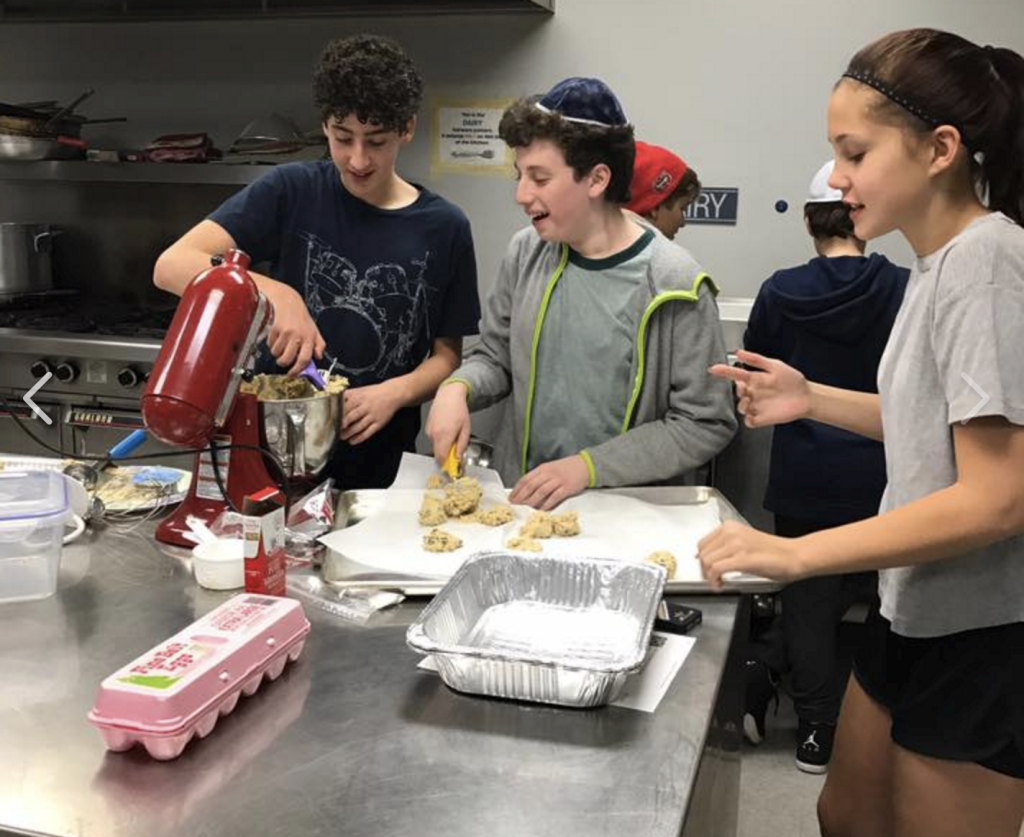 STOM Kids (Shomrei Teens of Montclair) prepare cookies for MESH Cafe, (Montclair Emergency Services for the Homeless)