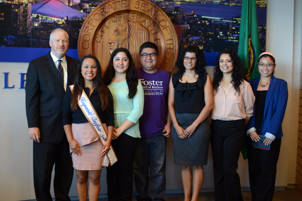 The mayor of Seattle poses with young people eligible for work and education authorizations through the federal Deferred Action for Childhood Arrival program.