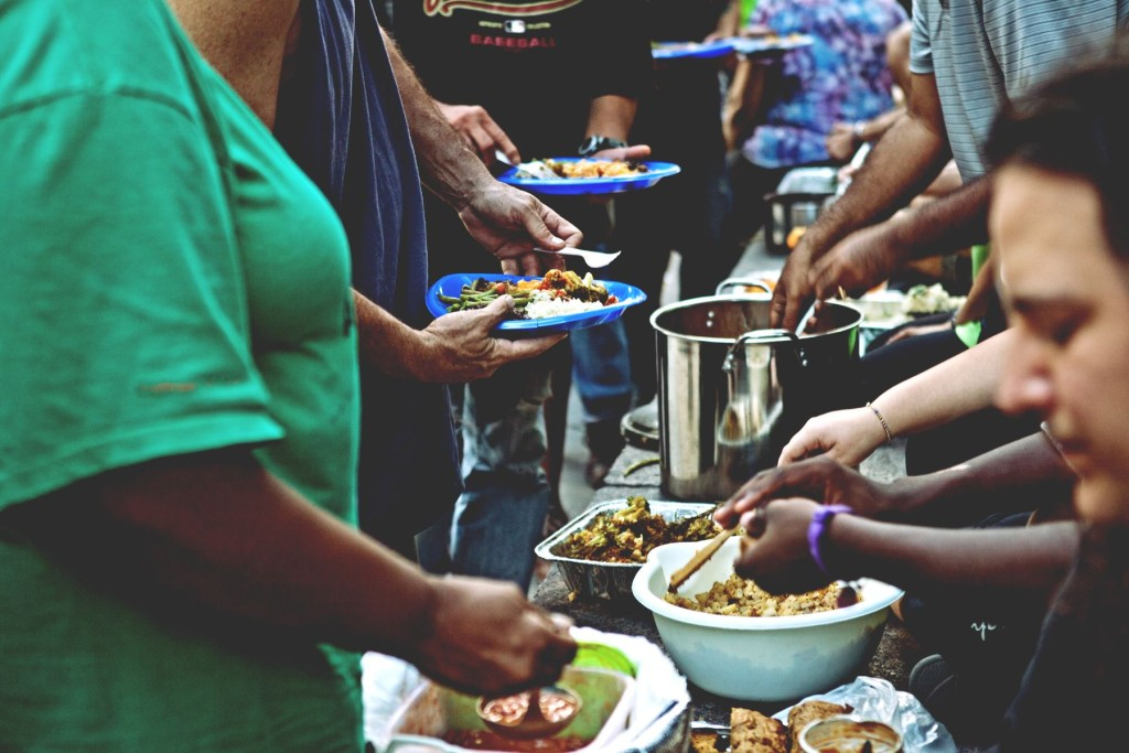 "Volunteers at ""Food Not Bombs"" feed the Homeless and Needy."