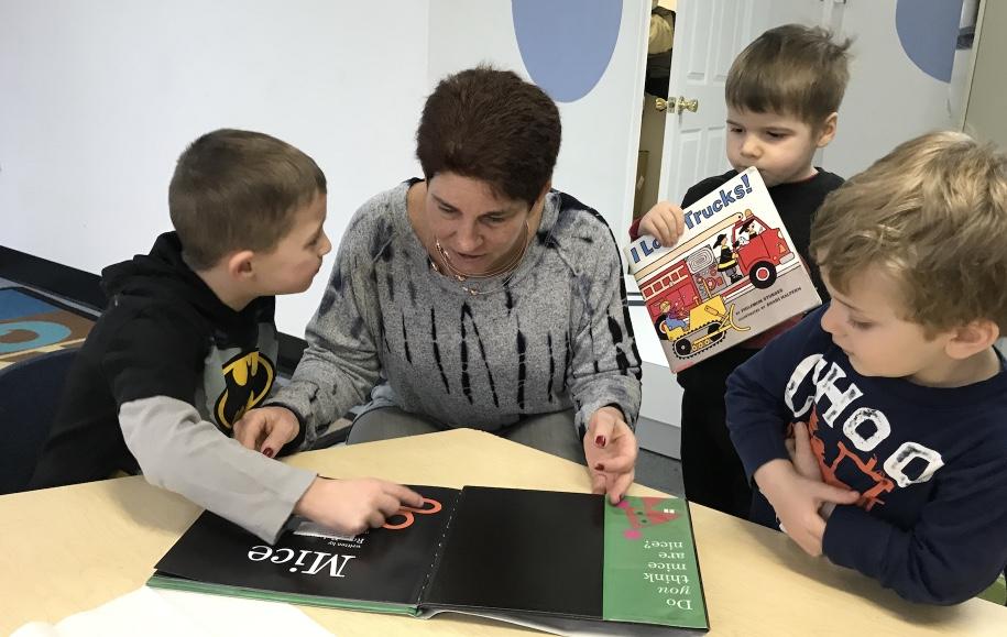 "President Fern Heinig visiting preschoolers at their temporary ""digs""."